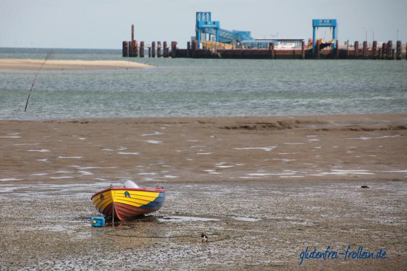 Amrum_Watt mit Ruderboot und Hafen